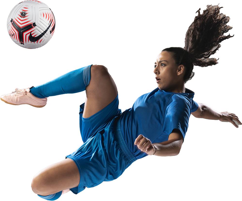 Football player in the air kicking a ball